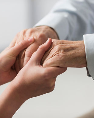 nurse-holding-senior-man-s-hands-for-sym