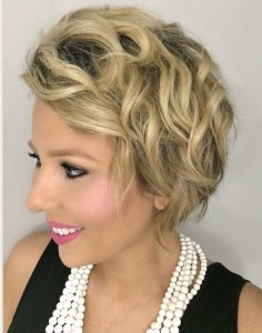 Short, post chemotherapy hair styles into textured curls.