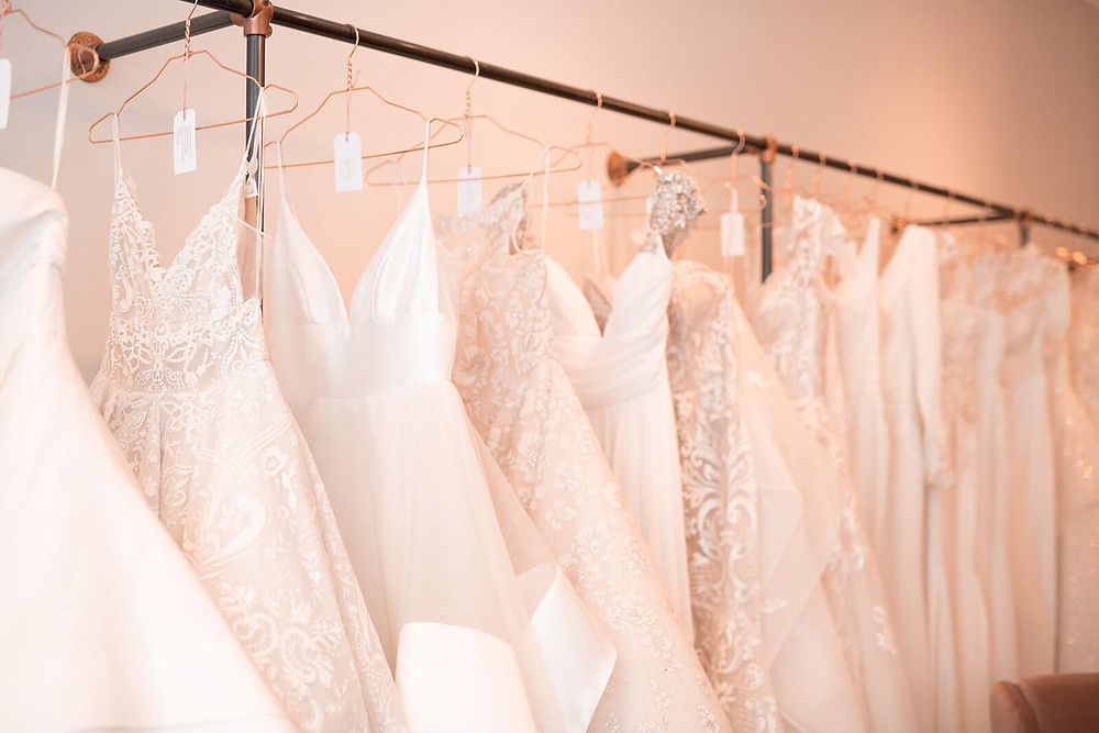 A rail of beautiful wedding dresses inside the boutique that are avilable to be tried on at Lavelle Bridal Couture.