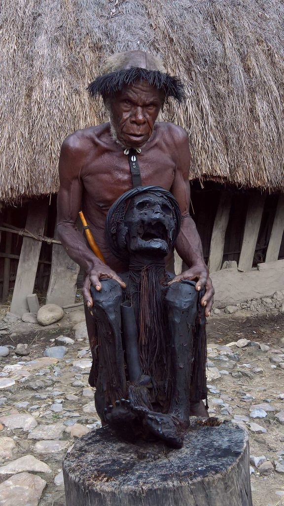 Dani village elder embracing the remains of his 350 year old ancestor. - Highlands of West Papua, Indonesia (February 2016)