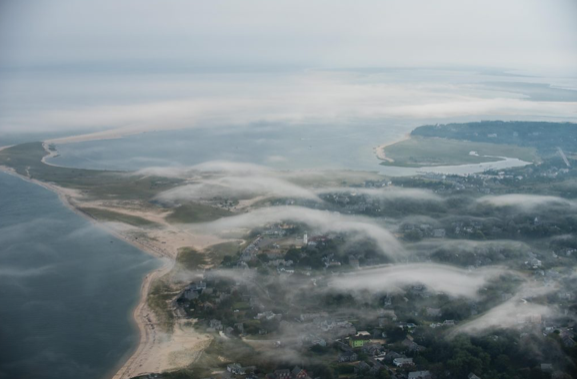 Fantastic moment captured as a fog bank slowly envelopes the Chatham landscape from the Southeast.