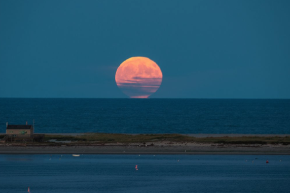 Harvest Moon rises over the outer beach in Chatham.