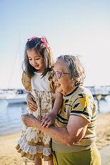 Grandma and grand-daughter walking together