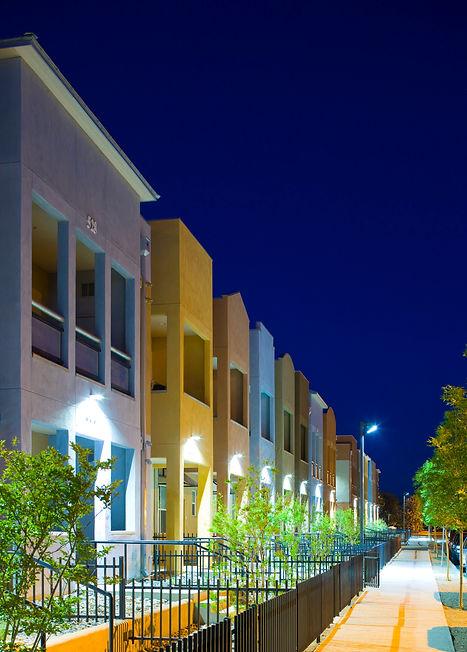 Plaza Feliz apartment complex lit up at night