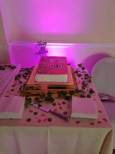 Pink uplit bday cake