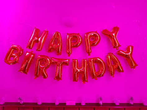 Pink uplit happy birthday sign
