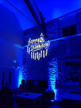 Happy birthday with blue up-lights