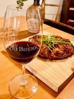 Rolf Binder wine glass and pizza.jpg
