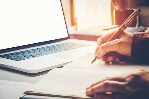 Close up businessman hand writing workin