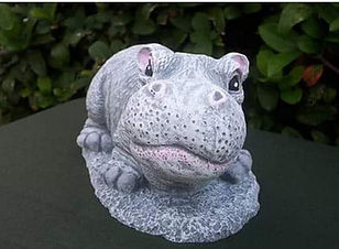 concrete hippos in hutto set in stone