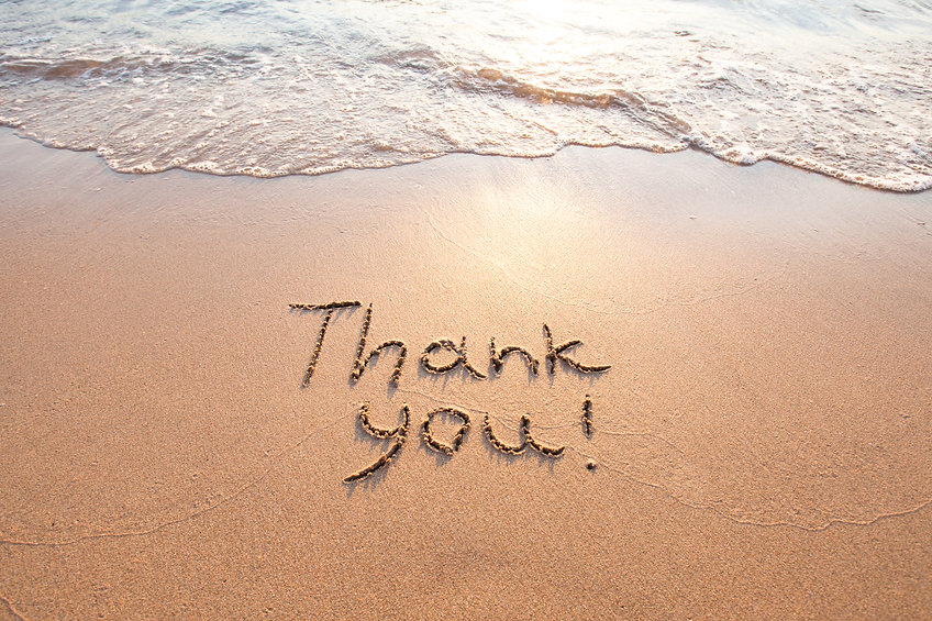 Thank You in sand on beach. Coaching Testimonials