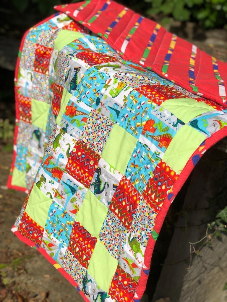 Dinosaur crib quilt
