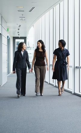 Businesswomen%20Walking%20in%20Hallway_e