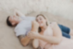 Couple lie on the beach in Kent.jpg