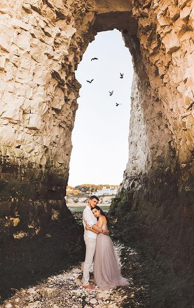 Elopement couple embrace on beach under