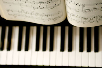 Piano keyboard with music