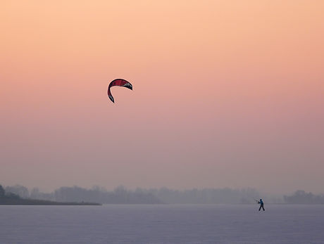 Kite surfing on a frozen lake in winter