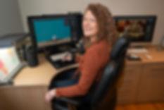 Joanne Craske, digital retoucher working in her studio