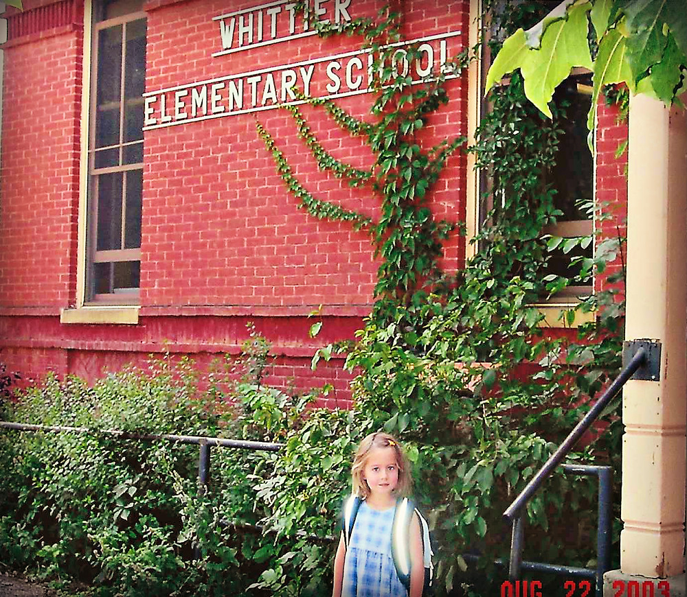 Kindergartener in front of Whittier International School, Boulder, CO