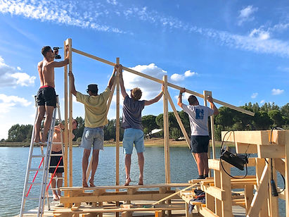 portugal crato waking life festival installation art on lake house collaborative interactive structure music festival foggy morning on the lake build photo