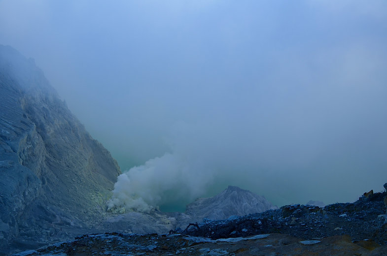 Photograph of chemical reactions in mountains hazy sulphuric clouds atmospheric craggy rocks