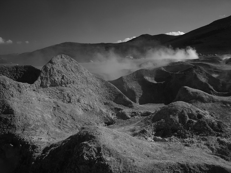 black and white photograph of gaseous reaction in mountains and rocks