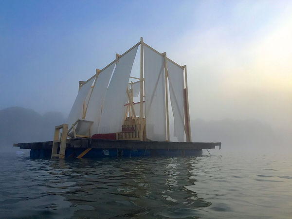 waking life festival installation art on lake house collaborative interactive structure music festival foggy morning on the lake
