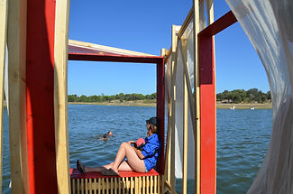 water window seat on a lake red