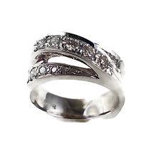14 karat white gold and diamond bridge ring.