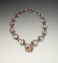 Necklace enameled with copper thread.