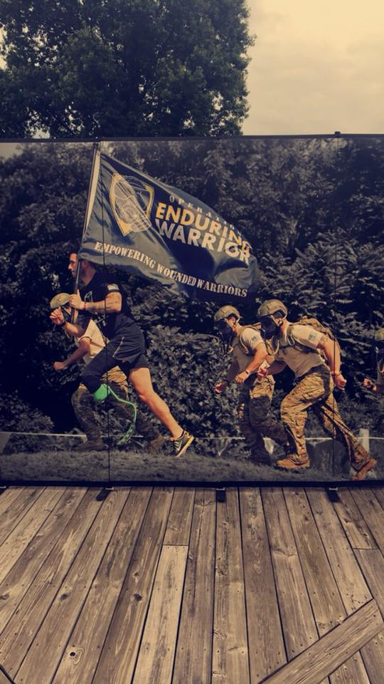 Single leg amputee charges uphill during obstacle race.