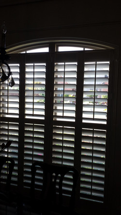 square shutter in arched window