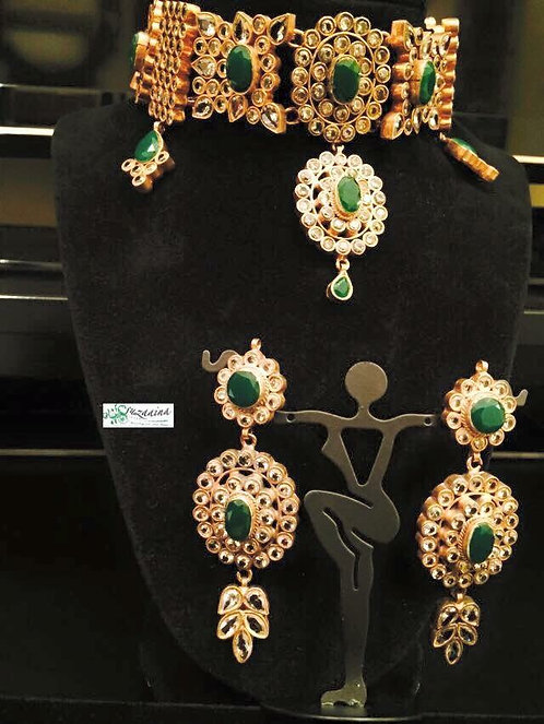 Hira Gold Plated Handcrafted Emerald and Kundan Choker Set.