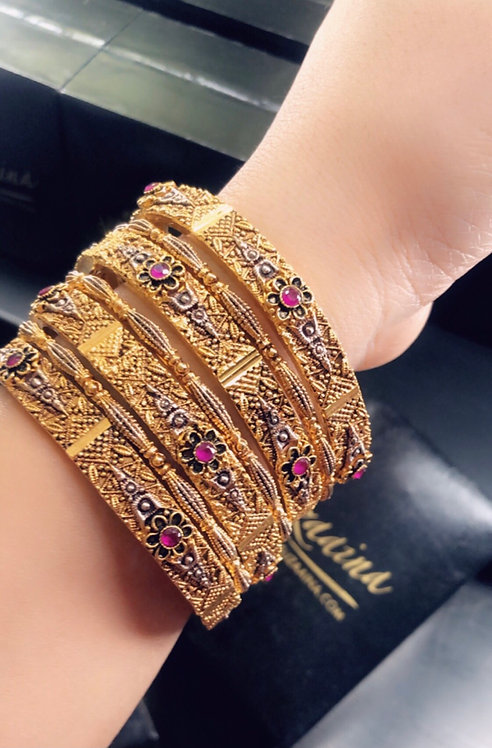 Xernish 22k Gold plated Handcrafted Set of Bangles .