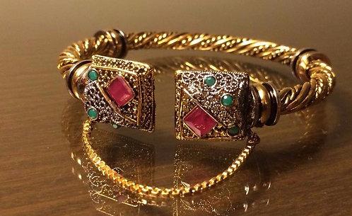 gold plated twisted kada bangle. free size