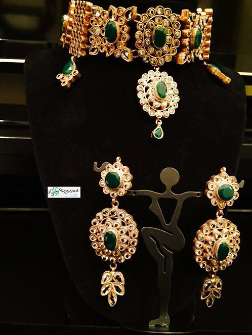 Hira Gold plated Handcrafted Emerald and Kundan Choker Bridal Set.