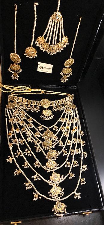 Simoj 22k Gold plated Kundan and Pearls Bridal Set.