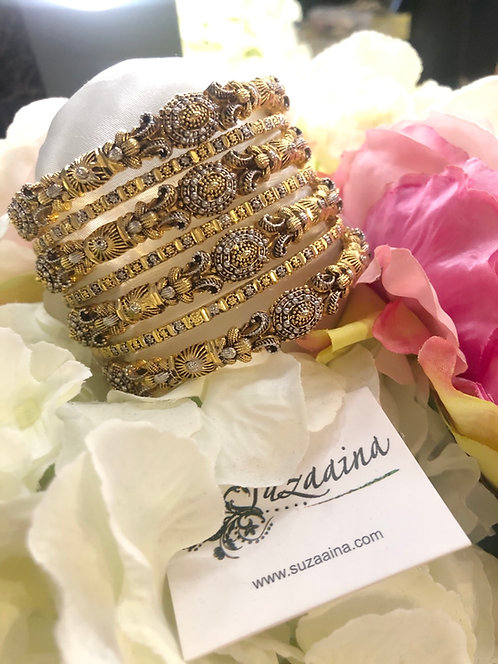 Midhat 24k Gold and Rhodium plated bangles .