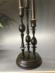 trio of ebonised candle holders