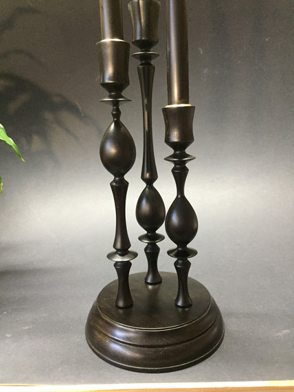 trio of ebonised candle holders