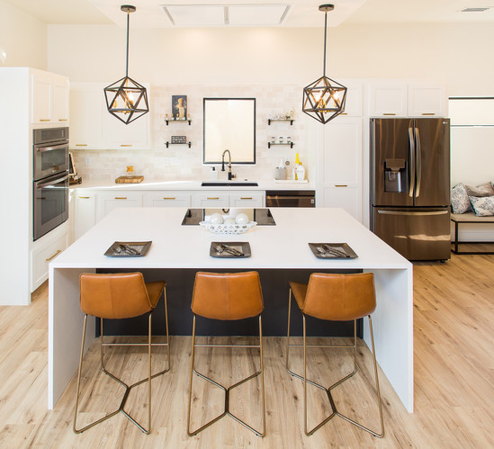 Modern open concept kitchen with warm natural accents