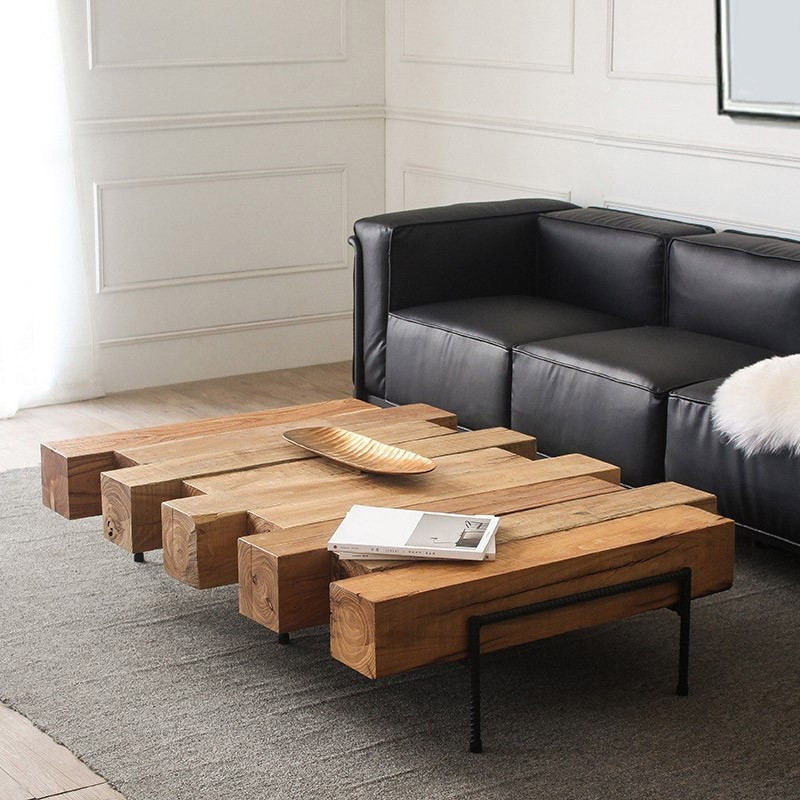 Raw unfinished coffee table with leather couch