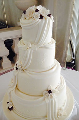 4 tier ivory wedding cake