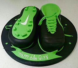 Hand carved 3D Nike Football Boots Cake.
