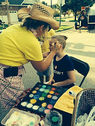 Face painting at the annual picnic