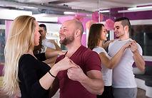 Happy young men and women having dancing