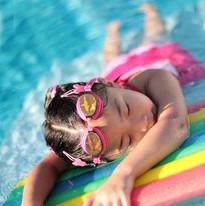 Girl_with_styrofoam_swimming_board.jpg