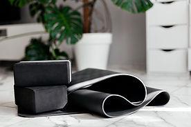 yoga at home. gray yoga mat and black yo
