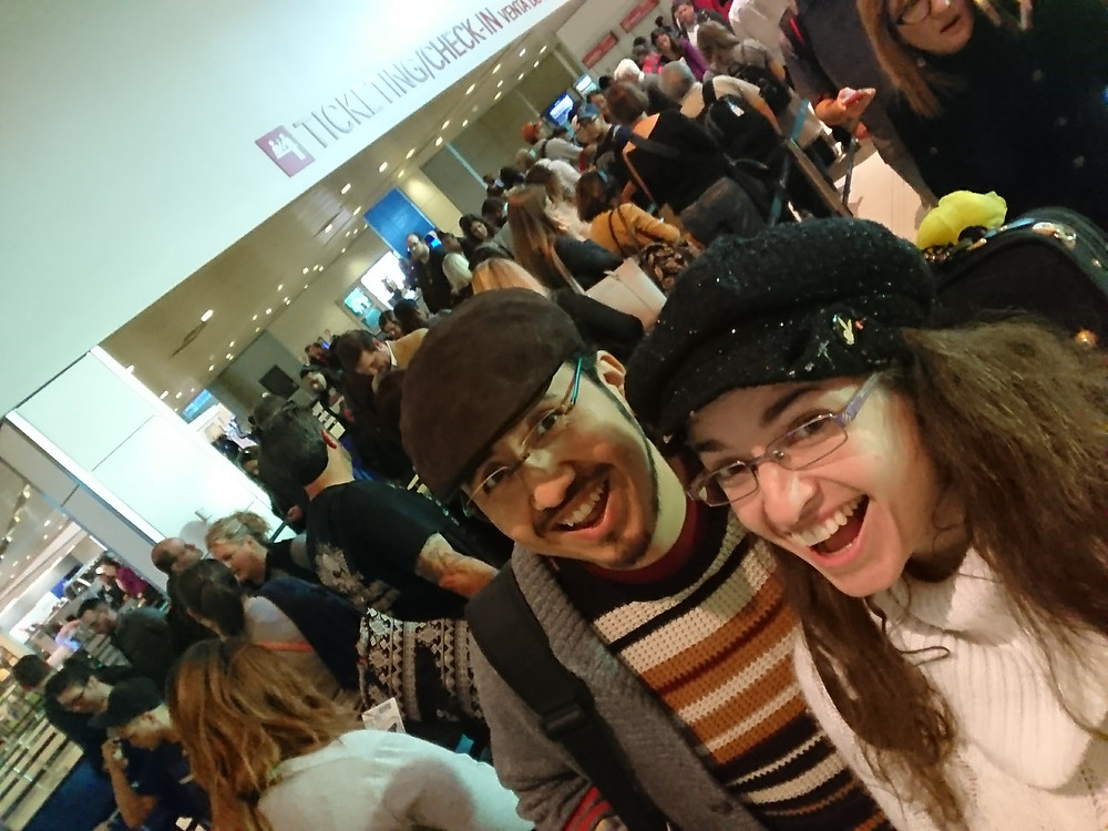 """Waiting in line at DAL with my videographer/video editor at the beginning of """"vacation""""!"""
