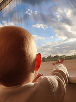 A baby looking at the horizon